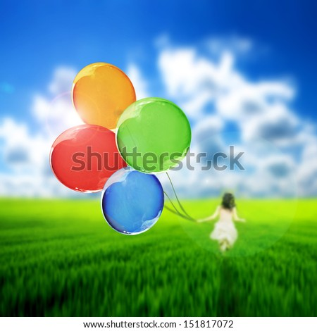 Kid playing with a bunch of colorful balloons - stock photo