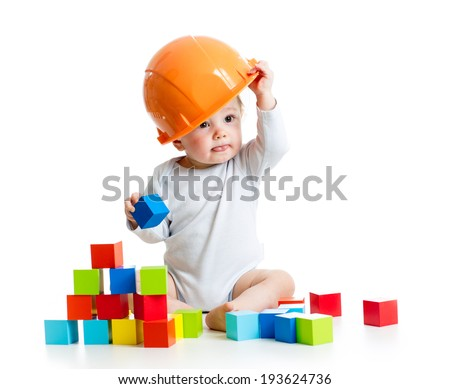 kid playing with building blocks toy - stock photo