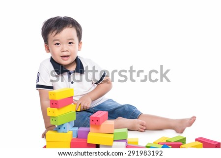 kid playing with building blocks toy isolated on white.