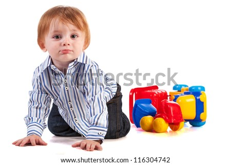 kid playing with car toy isolated - stock photo