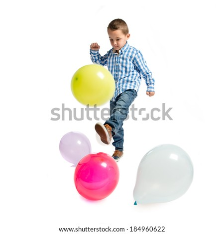 Kid playing with colorful balloons over white background  - stock photo