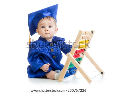 Kid plays with abacus toy. Concept of early learning baby - stock photo