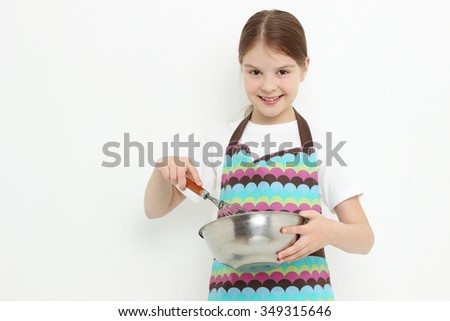 Kid preparing meal - stock photo