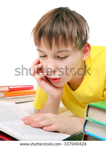 Kid read the Book at the Home on the White Background - stock photo