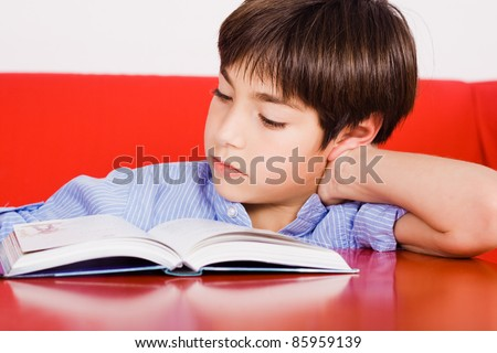 Kid reading a book - stock photo