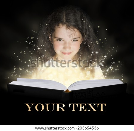 Kid reading the magic book - stock photo