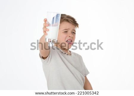 kid refuses to drink milk - stock photo