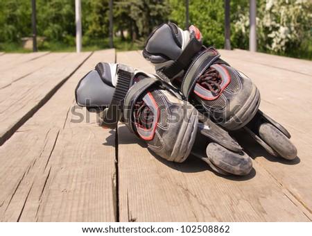Kid`s inline rollerblade against urban background. - stock photo