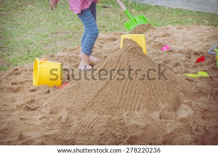 kid's toys for playing sand bucket and shovel, enjoy with activity of family - stock photo
