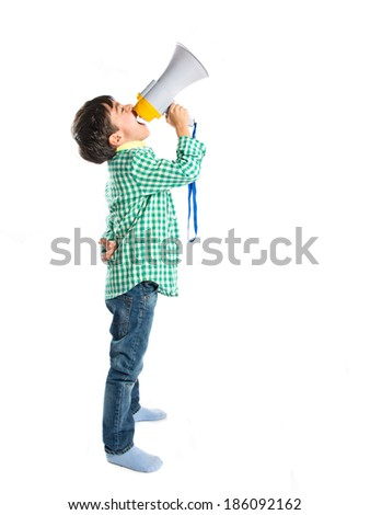 Kid shouting by megaphone over white background  - stock photo