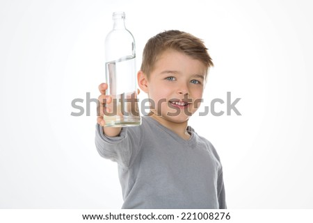 kid shows a bottle of water - stock photo