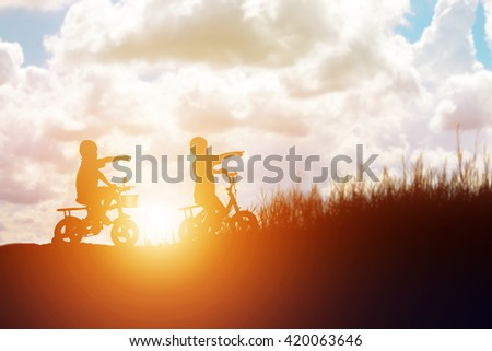 kid silhouette,Moments of the child's joy. On the Nature sunset - stock photo