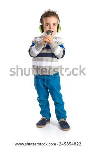 Kid singing - stock photo