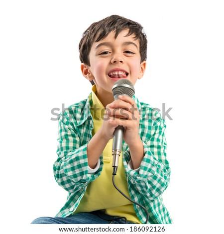 Kid singing over white background  - stock photo