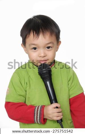 Kid singing, with black microphone  - stock photo