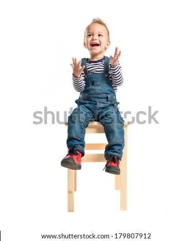 Kid sitting and clapping over white background - stock photo