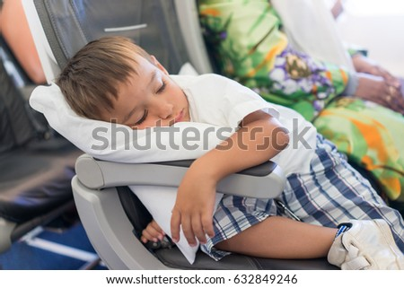 Kid sleeping inside the airplane during the flight