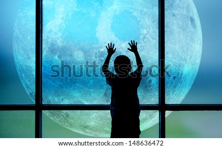 Kid standing and plays on window-digital compositing. Moon Globe shape courtesy of NASA - stock photo