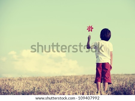 Kid standing in nature with large copy space - stock photo