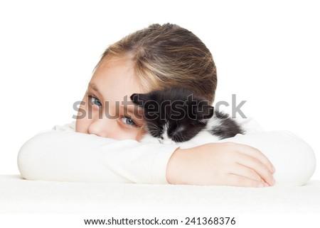 kid tenderly embraces kitten - stock photo