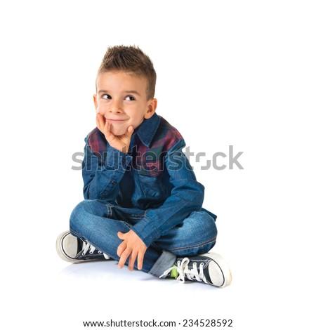 Kid thinking over white background - stock photo
