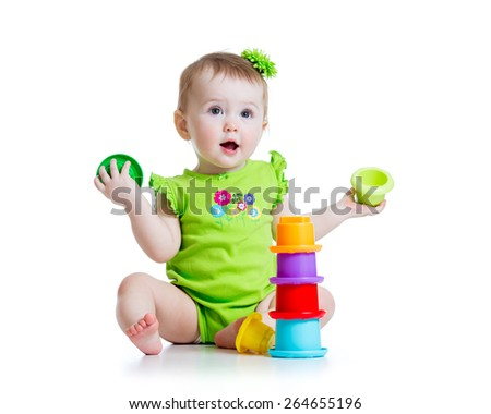 kid toddler playing with color toys isolated on white - stock photo