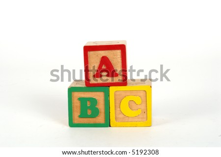 kid toy blocks spelling ABC on white background