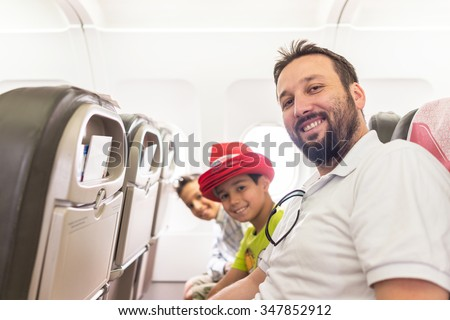 Kid traveling by airplane - stock photo