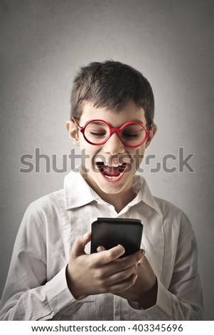 Kid using a smartphone - stock photo