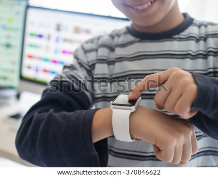 Kid using smart watch - stock photo