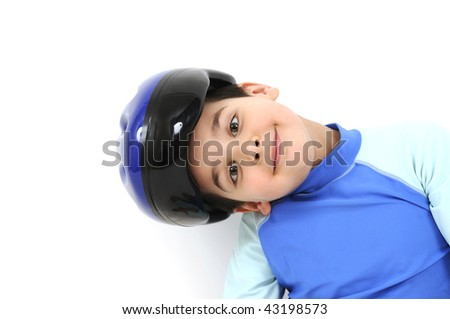 Kid wearing helmet and sportswear over white - stock photo