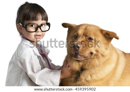 Kid wearing veterinarian outfit playing with dog