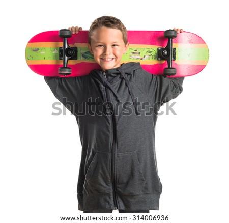 Kid whit his skate - stock photo