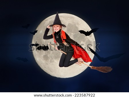 Kid witch flying on broomstick. Halloween moon.