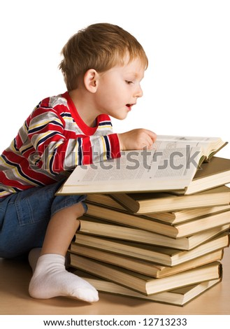 Kid with a pile of books - stock photo