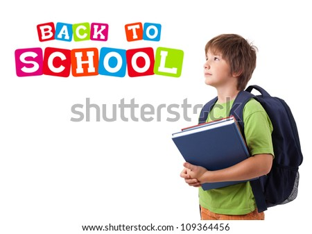 Kid with books with back to school theme isolated on white - stock photo