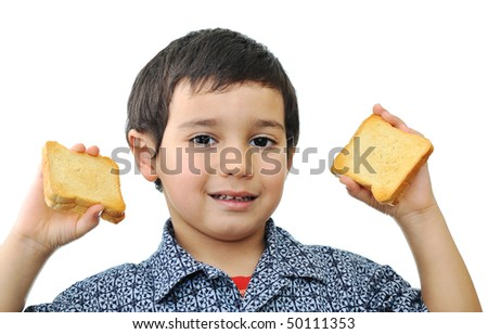 Kid with bread - stock photo