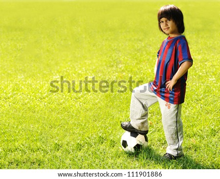 Kid with football on field