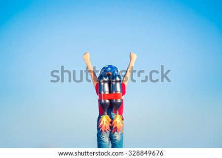 Kid with jetpack against blue sky. Child playing outdoors. Success, leader and winner concept - stock photo