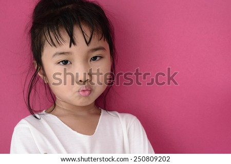 Kid with moody face while her sick mode - stock photo