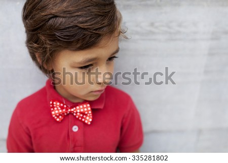 kid with red boy tie
