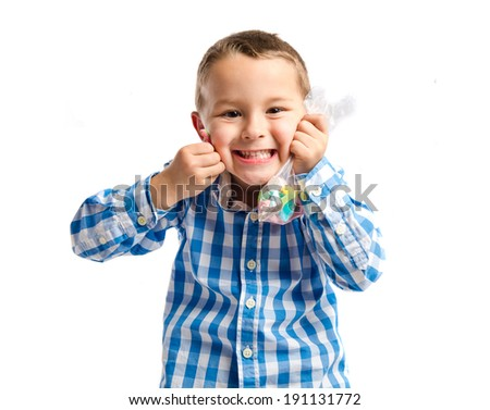 Kid with sweets over white background
