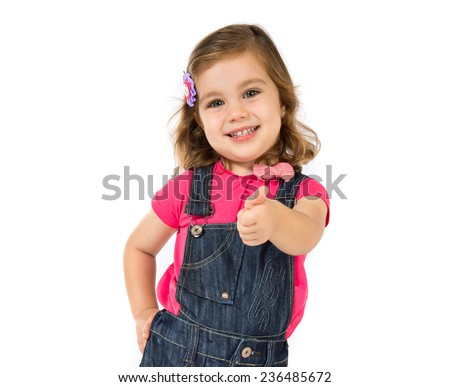 Kid with thumb up over white background - stock photo