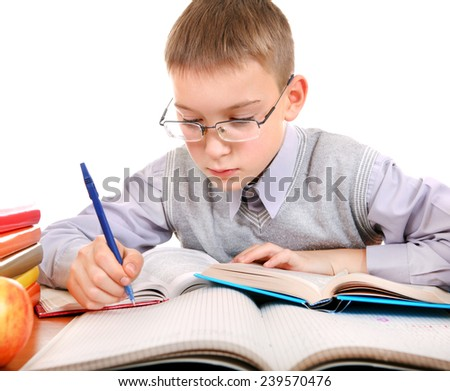Kid write at the School Desk on the white background - stock photo