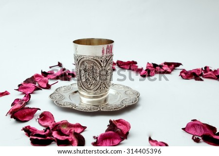 Kiddush cup on a white background - stock photo