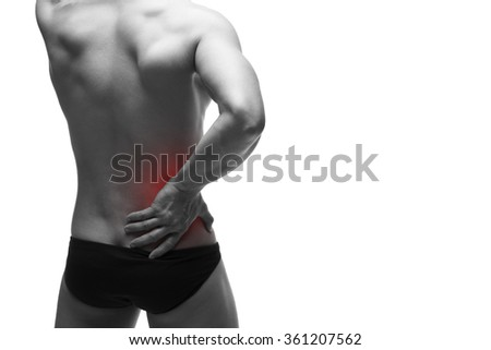 Kidney pain. Man with backache. Ache in the muscular human body. Isolated on white background. Black and white photo with red dot - stock photo