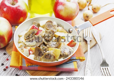 Kidneys beef in cider with apples on the table