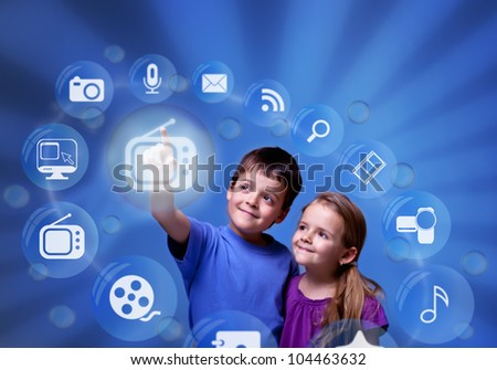 Kids accessing futuristic entertainment applications from the cloud computing interface - stock photo