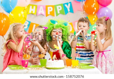 kids and clown at birthday party - stock photo