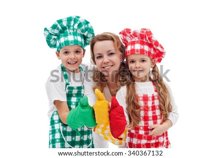Kids and their mother preparing food together - dressed as chefs, isolated - stock photo